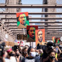 Thousands of protesters walk in a peaceful protest across the Brooklyn Bridge holding signs that ...