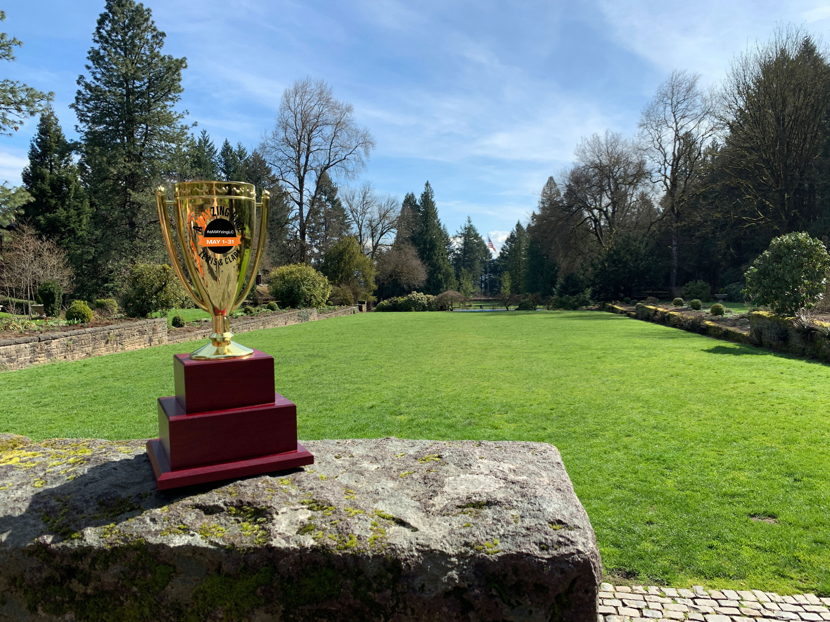 A-May-zing Race trophy in front of flag lawn