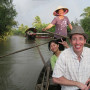 Associate Professor of Japanese Bruce Suttmeier travels along the Mekong Delta in Vietnam on an o...