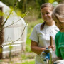 Students practicing permaculture at Tryon Life Farm as part of Spring Into Action Community Servi...