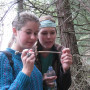 Students examine a tree core as part of a hike in southern Oregon. This rural part of the state h...