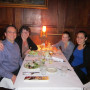 Laura Mundt, Community Friends Coordinator, and her family enjoy a good-bye dinner with Nazik at ...