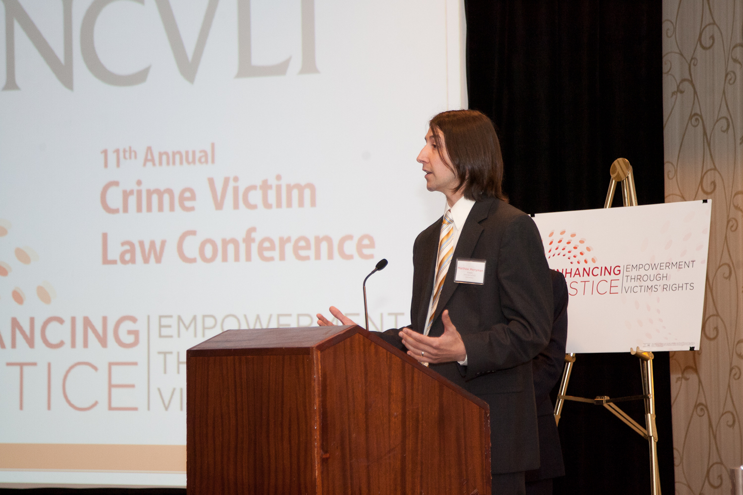 Law Student Matthew Merryman accepts NCVLI's Volunteer of the Year Award at the 11th Annual Crime Victim Law Conference.