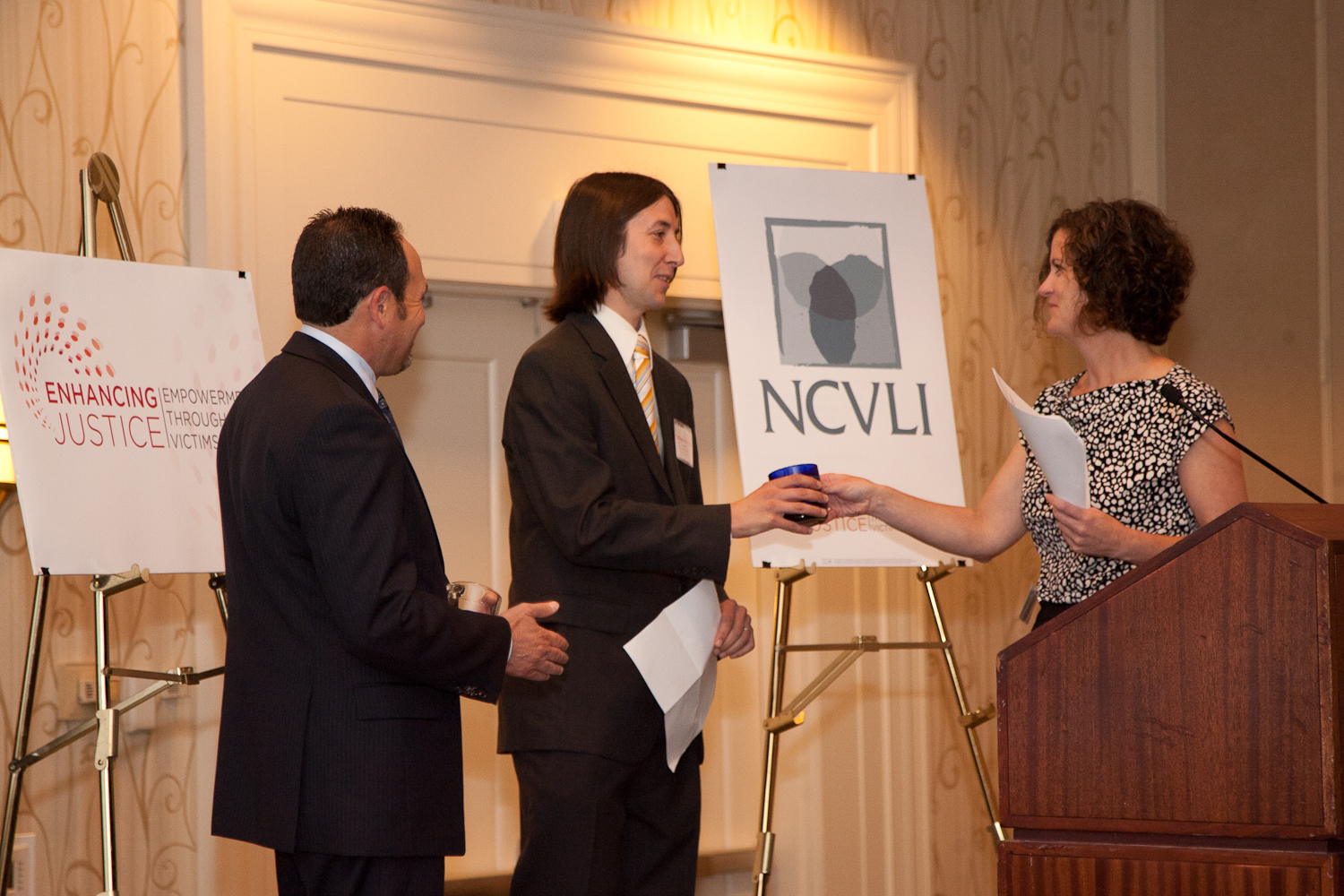 Law Student Matthew Merryman accepts NCVLI's Volunteer of the Year Award from NCVLI Executive Director Meg Garvin.