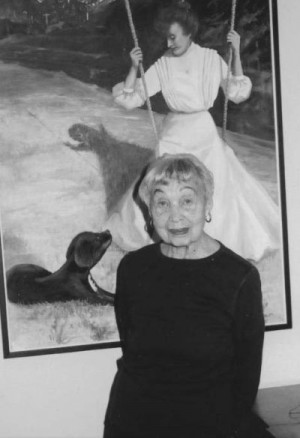 Marion Beals poses in front of one of her own paintings.