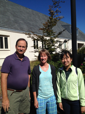 Community Friends volunteers, Bob and Gail Mueller and AES student Yukina Saito