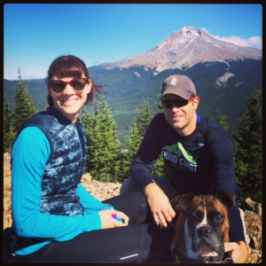 Andrea and her husband Ryan with their Boxer Daisy on top of Tom Dick and Harry Mountain—a two-...