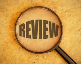 Image of the word review under a magnifying glass.