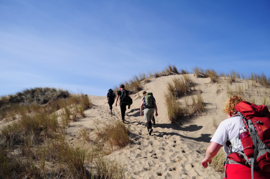 Students on a hike over sand dunes at the Oregon coast