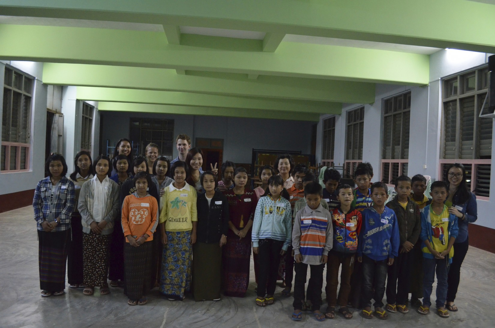 2014 100 Projects for Peace winners Sam Shugart, Nway Khine, Irada Yeap, and Katie Schirmer with their students in Taunggyi, Myanmar during summer 2014.