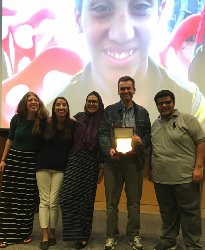 Burnley Truax, Isabella Irtifa, Reham Bahauddin, Brian White, and Hamdan Alameri with plaque honoring L&C's 2016 Project for Peace, done in cooperation with the Resala Association for Charity in Egypt.