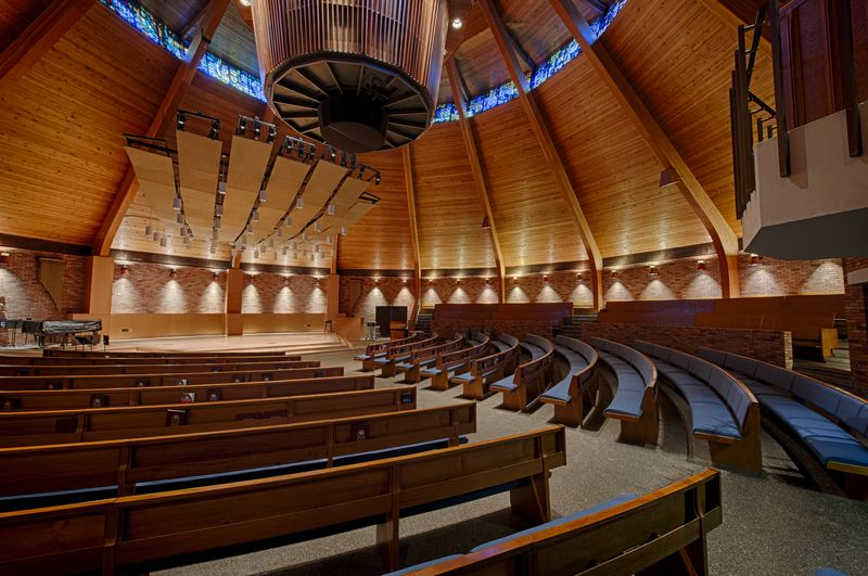 The lovely Agnes Flanagan Chapel features floor and raised pew seating, well-lit modern stage, an...