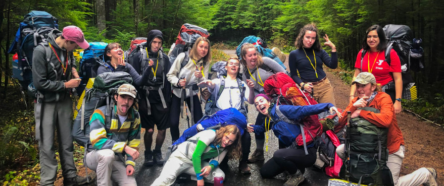 Image Description: A group of people dressed for backpacking make a silly pose