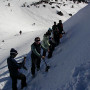 Participants look at the deeper layers of snow that can contribute to avalanches.