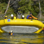 Participants learn how to flip their raft to prepare for worst-case scenarios.