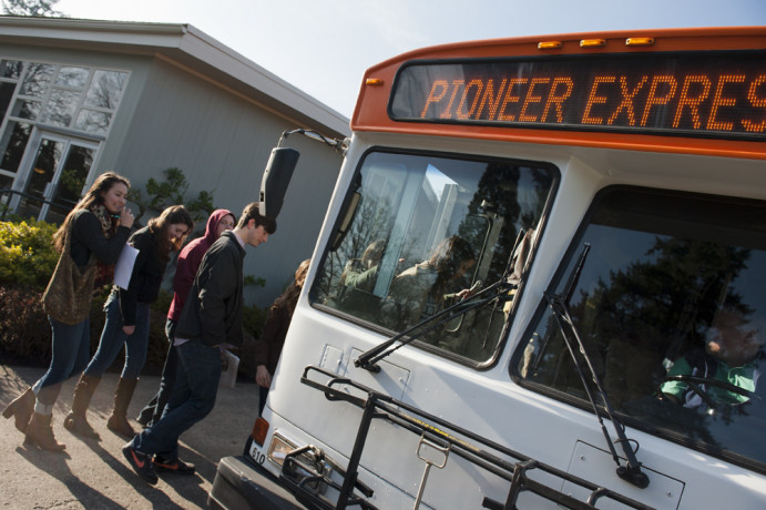 Students boarding the Pioneer Express, a free shuttle that goes downtown.