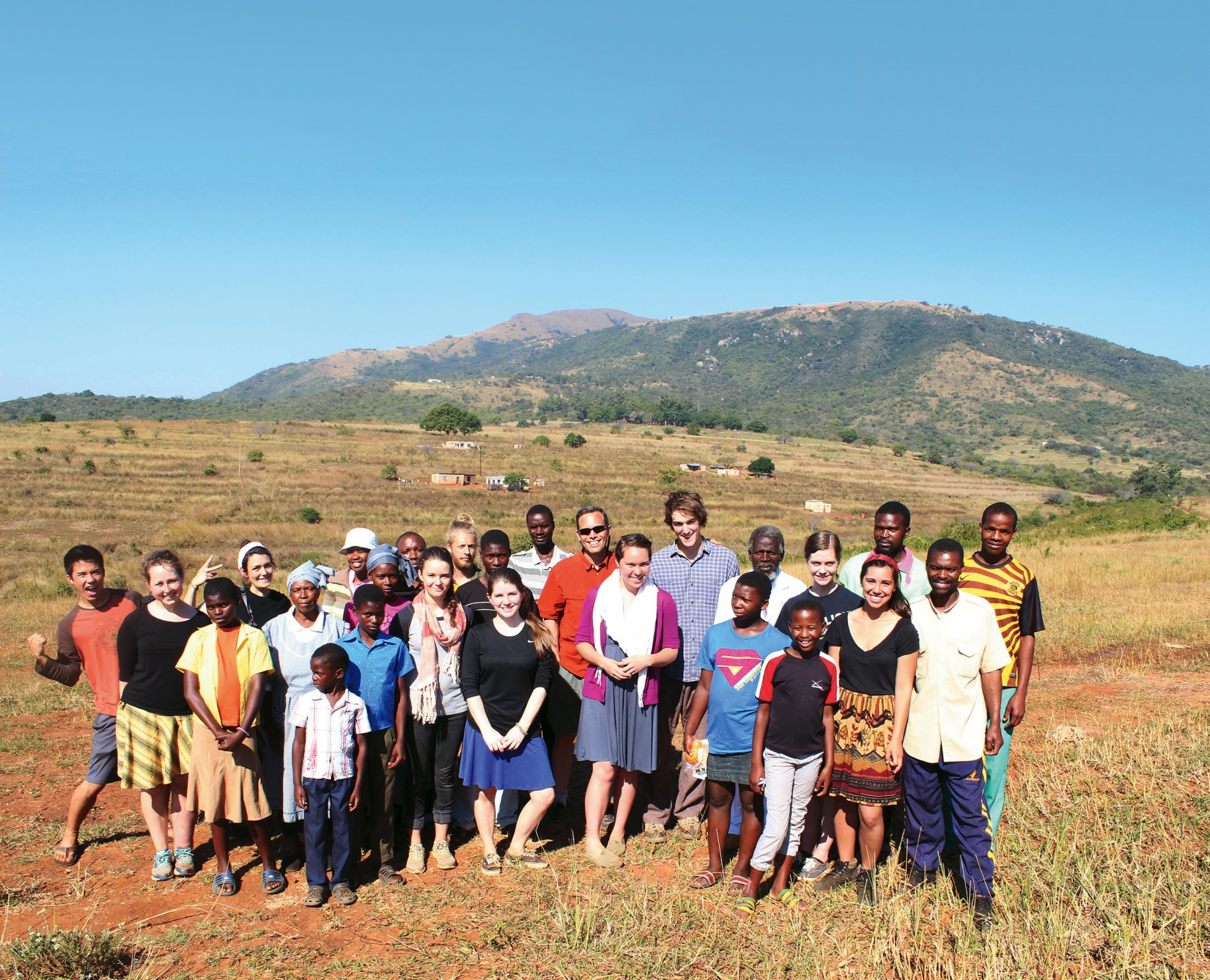 Students and sponsors at a rural homestead stay in Ngebeni.