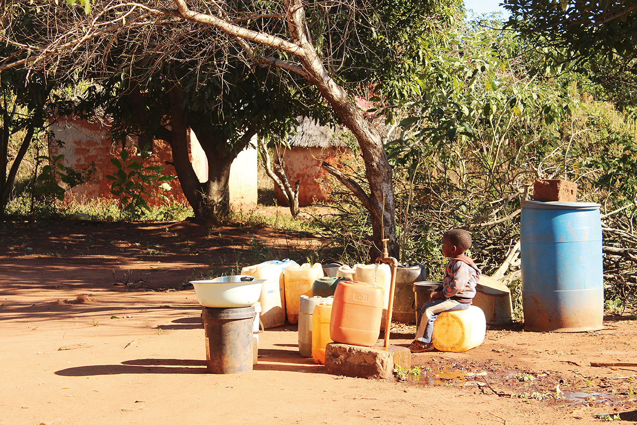 Fetching water from a community tap.