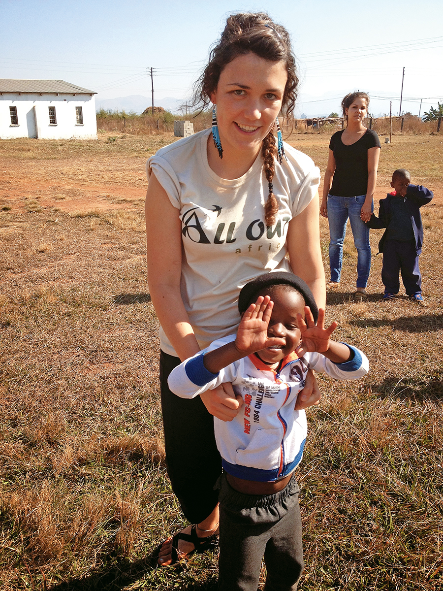 Miriam Coe CAS '14 with a young friend at Mahlanya Neighborhood Care Point.