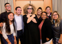 Ruth Carter demonstrates the Wakanda salute from the movie Black Panther with L&C's Inc...