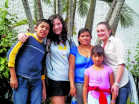 Lucy Roberts CAS '14 and Mia McLaughlin CAS '14 with their host family in El Salvador.