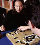 Above: Amanda Venghaus '04 plots her next move against Peter Drake, assistant professor of comp...