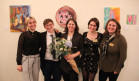 Symposium director Kim Brodkin (center, with  flowers) with student cochairs Hannah Daniels, Alex...