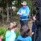 Bob Carlson interacts with kindergarteners on a senses walk in the CREST garden.