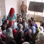 In small village schools such as this one, established by CARE in Shakardara, just north of Kabul...