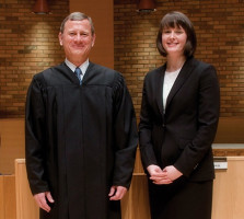 John G. Roberts, Jr., Chief Justice of the United States, and third-year law student Meredith Price, Advocate of the Year.