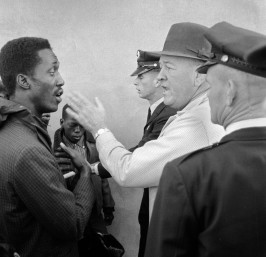 Sheriff Bill Lee (right) slaps Tom Gilmore as Gilmore leads a march to integrate schools. Following this incident, local minister and civil rights leader William McKinley Branch and SCLC staff member James Orange courageously suggested that Gilmore should seek the office himself. Following an initial 1966 defeat (due to voter irregularities), Gilmore was elected in 1970 and served as sheriff of Greene County until 1983. Eutaw, Alabama, 1965.