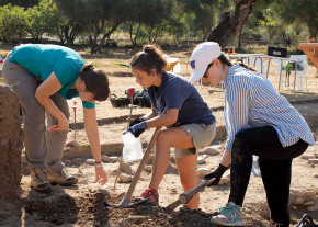 Students excavate bones, pottery, and other artifacts in the ancient ruins of Pollentia, a city f...