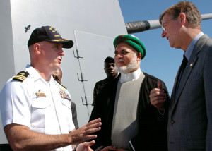 Niels Marquardt (right) and Commander Dean Vesely (left) welcome Comoran President Mohamed Sambi ...