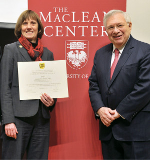 <em>Tolle, recipient of the 2014 MacLean Center Prize in Clinical Ethics, with Dr. Mark Siegler, the center's director.</em>
