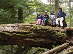 Carlson hikes with students through the forests of Orcas Island on a spring break trip.
