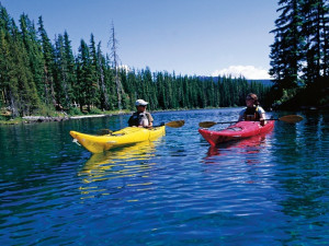 Kyle Miller '10 (left) and Rachael Skinner-Green '10 strike out to kayak Waldo Lake, rated th...