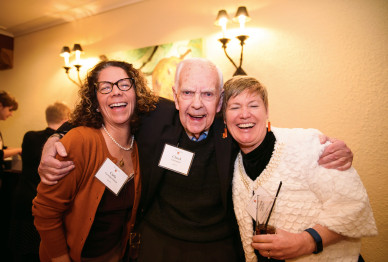 Carla Cavenago-Salazar BA '89, Chuck Charnquist BS '58, and Ginger Moshofsky BA '83 share a...