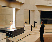Levinger pauses for a moment of contemplation in the Hall of Remembrance at the Holocaust Museum.