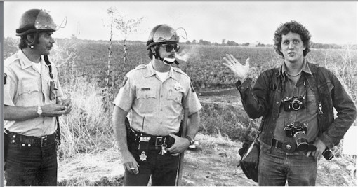 Bob Fitch, far right, accompanied by California Highway Patrol officers. Salinas, California, 1973.