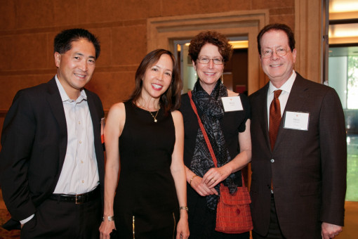 President Barry Glassner and his wife, Betsy Amster, with Trustee Heidi Hu B.S. '85 and her hus...