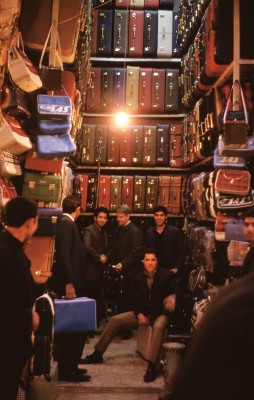 1968: Rick Price '72 (seated) at a suitcase shop in the Tajrish Bazaar, north of Tehran.
