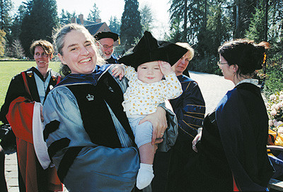 Nora Beck, associate professor of music, celebrates the occasion with her son, Alexander.