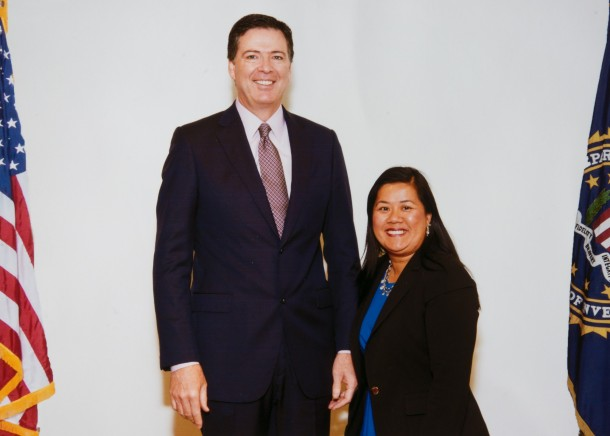 Chanpone Sinlapasai receives the 2014 FBI Director's Community Leadership Award from FBI Director James Comey.