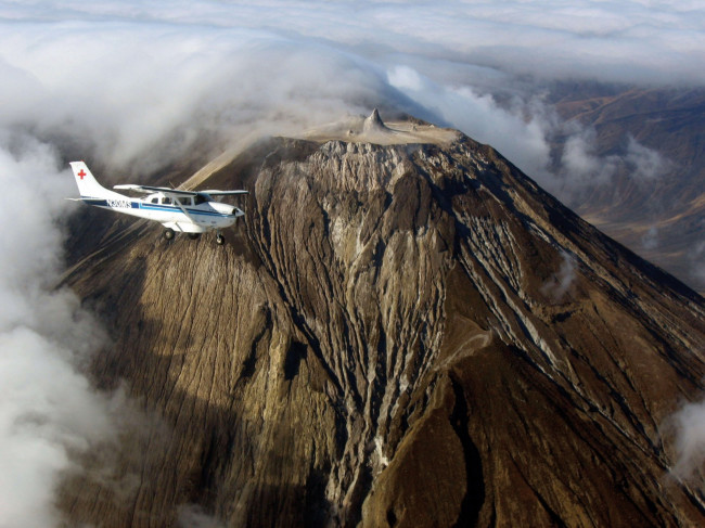 Rebecca Moran and her husband, Ezra Jay, each fly medical relief planes near Ol Doinyo Lengai (�...