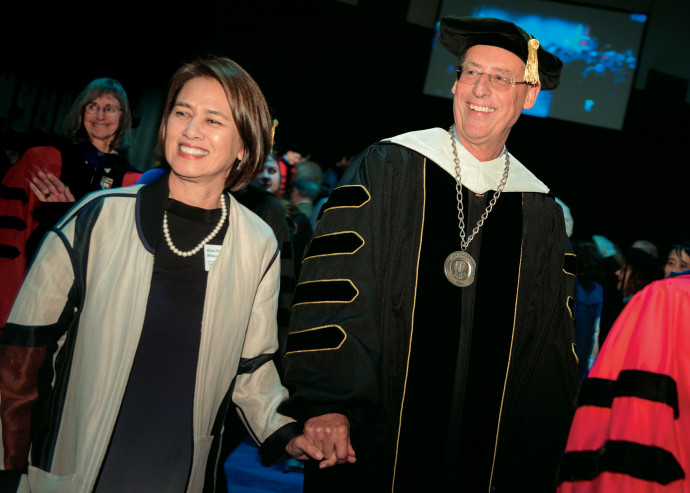 President Wim Wiewel and wife Alice depart the inauguration ceremony amid cheers from well-wishers.