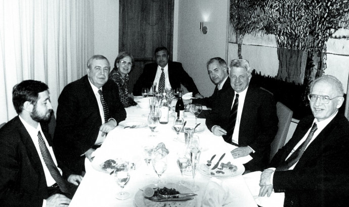 Russia's minister of atomic energy, Aleksandr Rumyantsev (second from left), at a 2002 dinner for Thomas Neff (second from right). Rumyantsev and Neff worked together on the uranium purchase agreement.