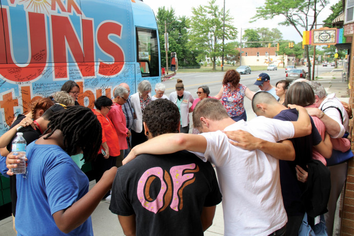 A group hug at a stop along the Nuns on the Bus tour.