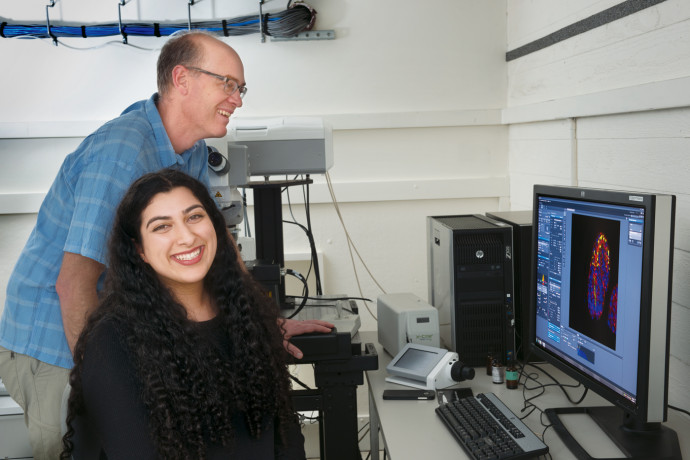 Simran Handa BA '19 works with Greg Hermann, professor of biology and department chair, on his cell biology research. Handa is one of several first-generation students participating in the college's Pathways to Success in STEM (science, technology, engineering, and math) program. (Robert Reynolds)