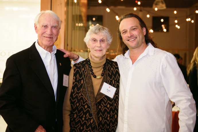 Life Trustee John Bates and Susan Bates with Aaron Meyer BA ?95, rock violinist, who provided the...
