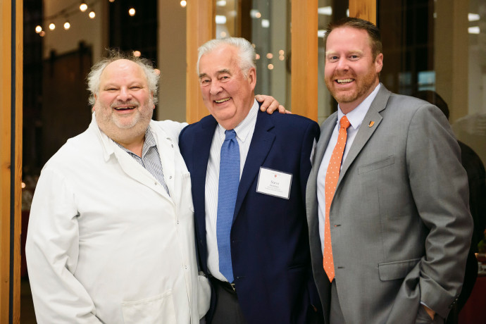 Beckham (center) with dinner host Jake Greenberg BA ?79 (left) and Vice President for Institution...